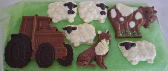 Hand-made chocolate farm animals and tractor