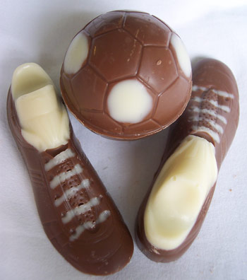 picture of milk chocolate football boots and footaball