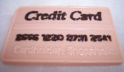 a picture of a milk chocolate credit card decorated with coloured chocolate