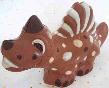 a picture of a milk chocolate dinosaur decorated with white and dark chocolate