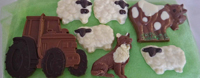 a picture of milk chocolate farm animals and tractor