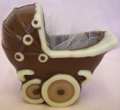 a picture of a milk chocolate pushchair decorated with milk chocolate