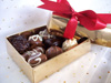 a picture of mixed truffles in a gift wrapped box