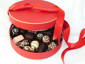 a picture of mixed truffles in round box