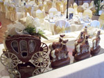 milk chocolate carriage and horses decorated with a gold rein