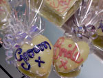 a picture of small chocolate love hearts, one with 'Groom' and one with 'Bride' written in coloured chocolate