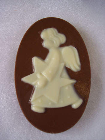 a picture of white chocolate angel on a milk chocolate base.