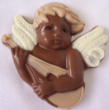 a picture of a milk chocolate cherub, decorated with white and coloured chocolate.