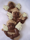 a picture of three chocolate musical cherubs