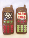 a picture of two milk chocolate Chrismas moblie phones